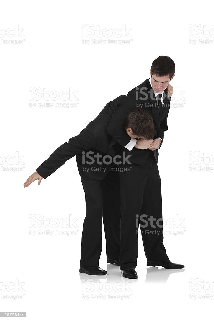 Two businessmen fighting stock photo