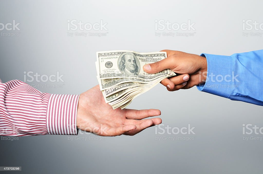 Two businessmen giving cash for bribe and corruption stock photo