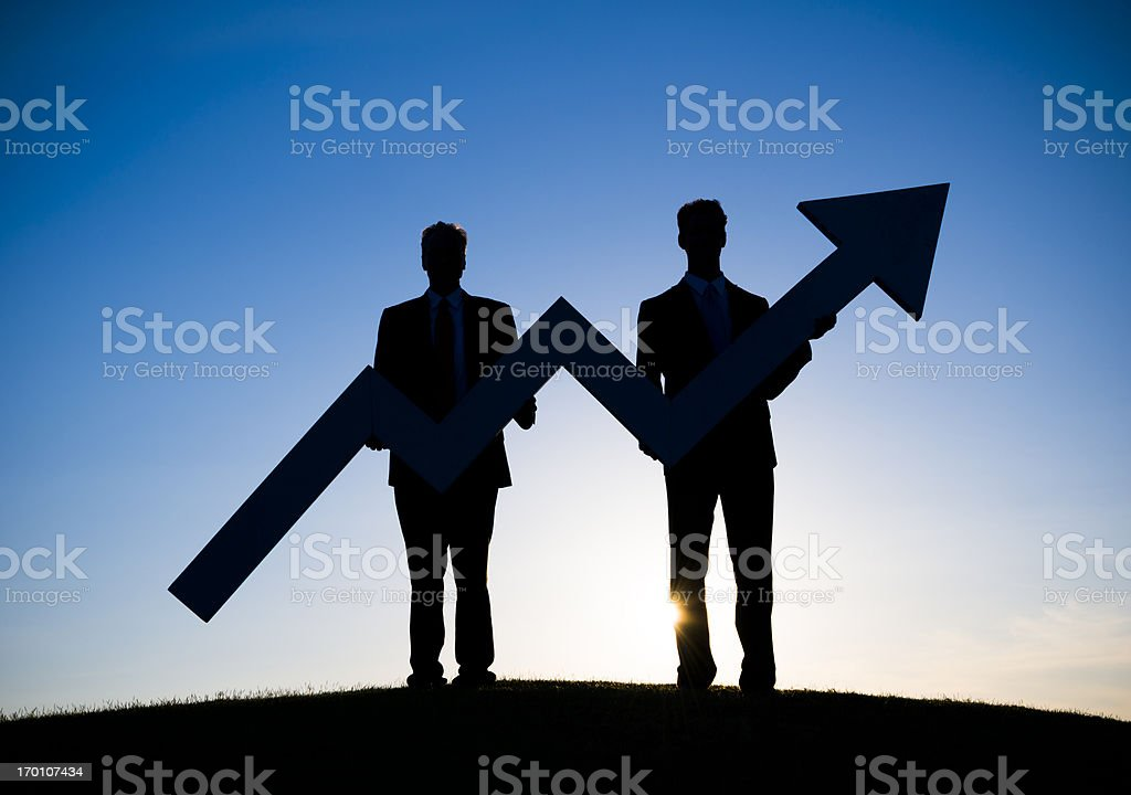 Two Businessmen holding the increase graph royalty-free stock photo