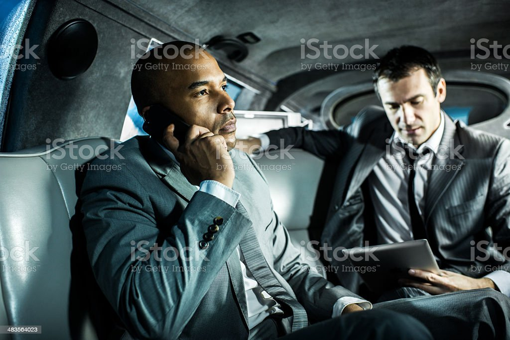 Two businessmen in a limousine. royalty-free stock photo