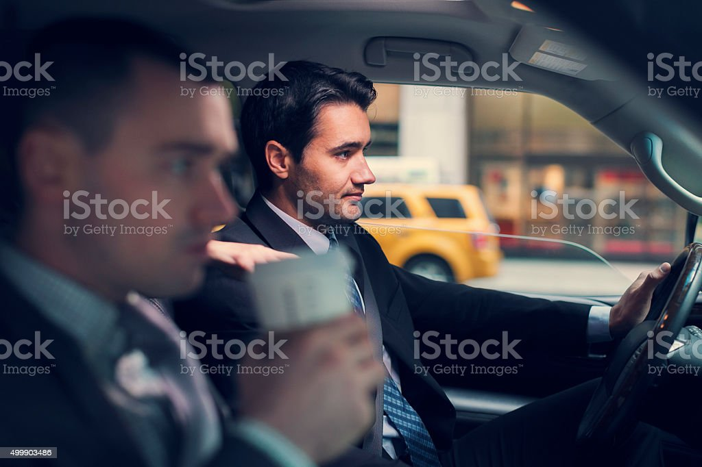Two businessmen in car stock photo
