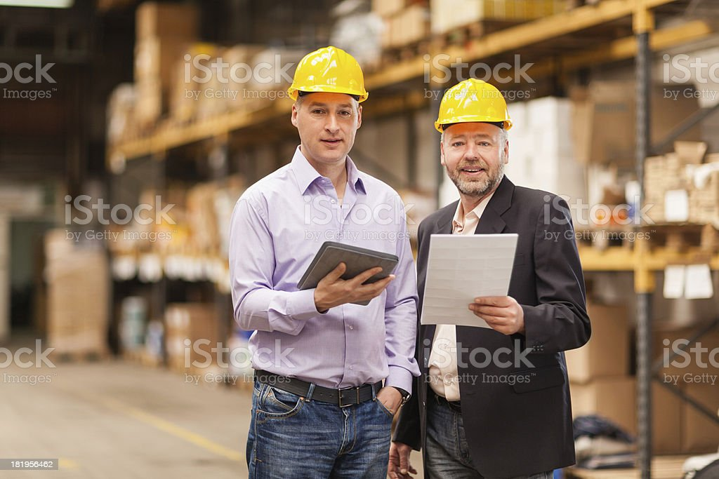 Two businessmen in warehouse royalty-free stock photo