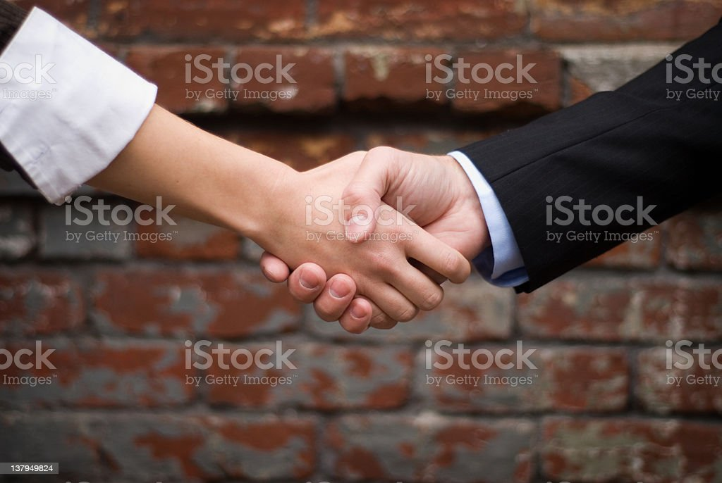 Two businessmen making a deal with a handshake royalty-free stock photo