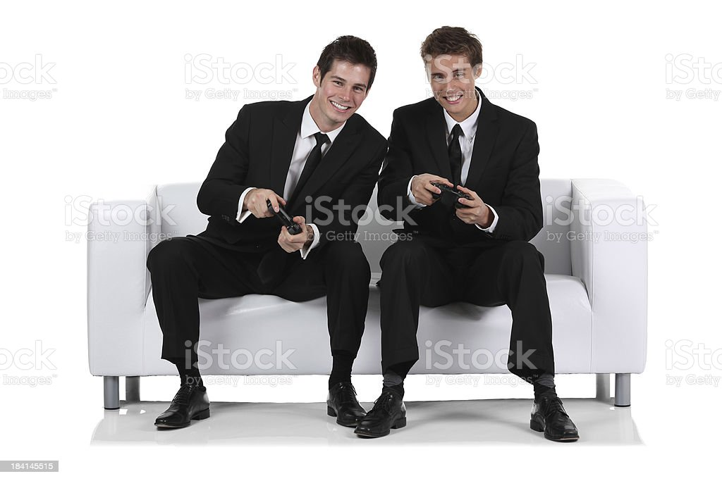 Two businessmen playing video game royalty-free stock photo