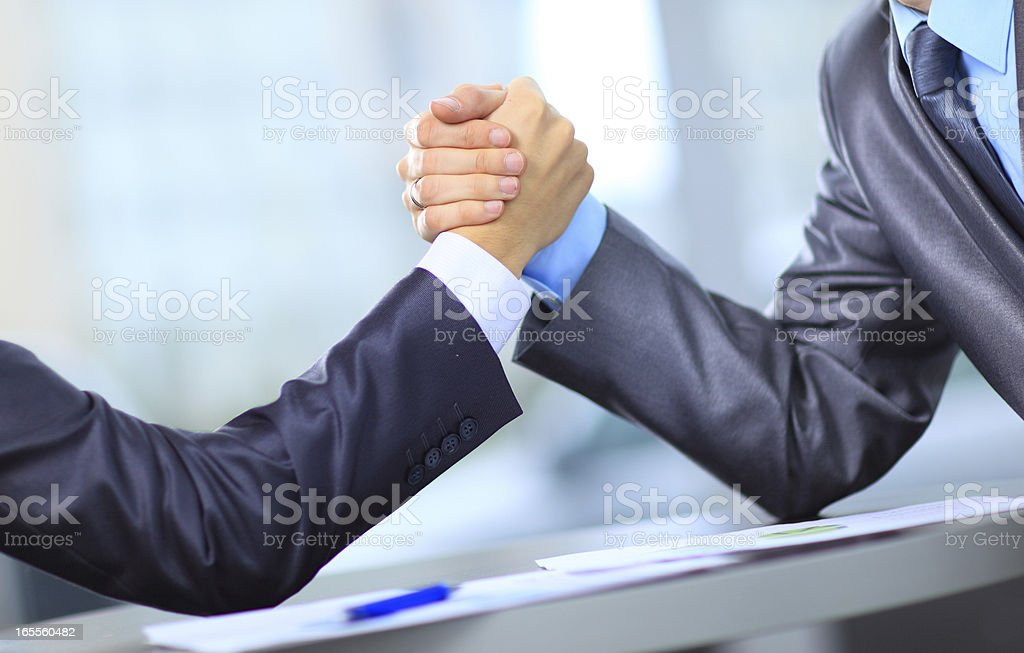 Two businessmen press hands each other on a forward background royalty-free stock photo