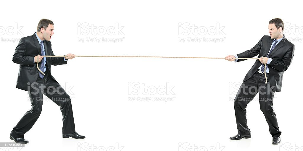 Two businessmen pulling a rope stock photo