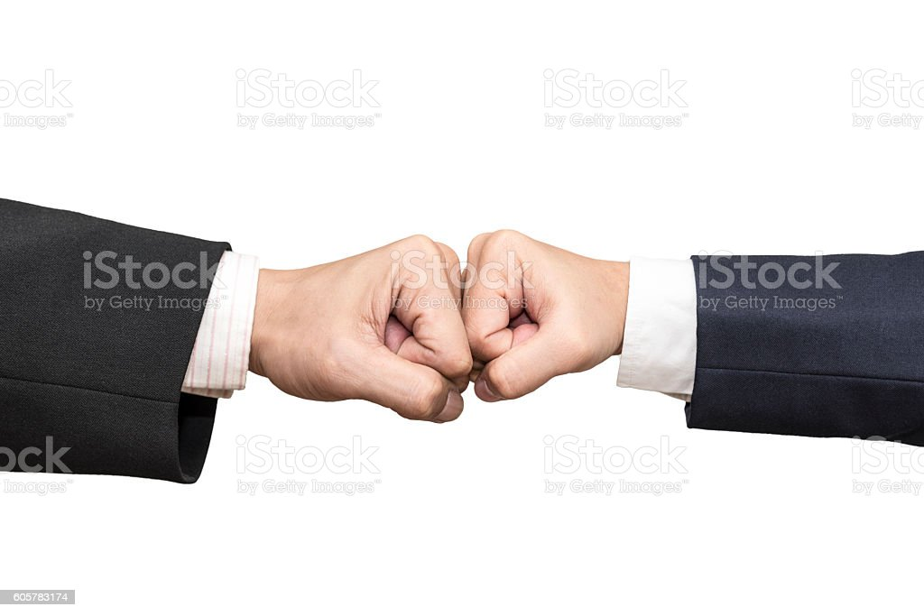 Two businessmen punch hands each other isolated on white background stock photo