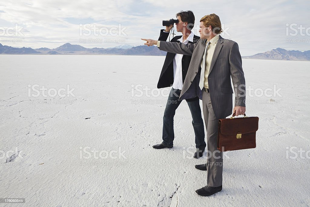 Two businessmen searching for the next investment opportunity royalty-free stock photo