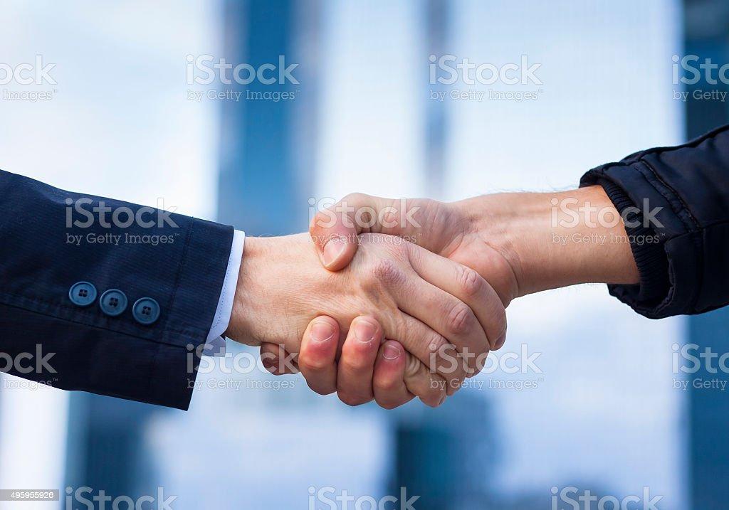 Two businessmen shaking hand stock photo