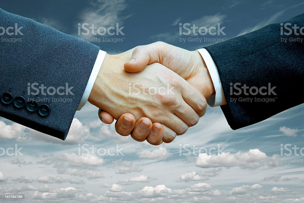 Two businessmen shaking hands after making a deal royalty-free stock photo