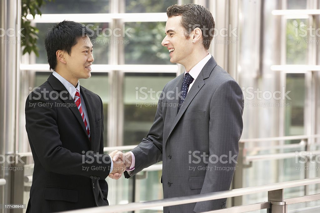 Two Businessmen Shaking Hands Outside Office royalty-free stock photo