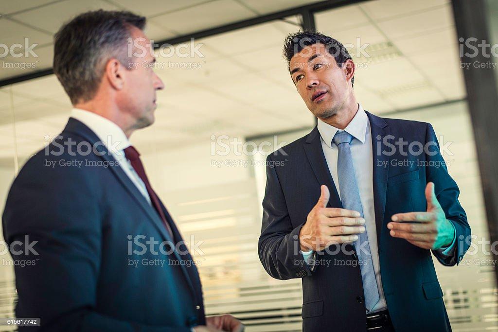Two businessmen talking stock photo