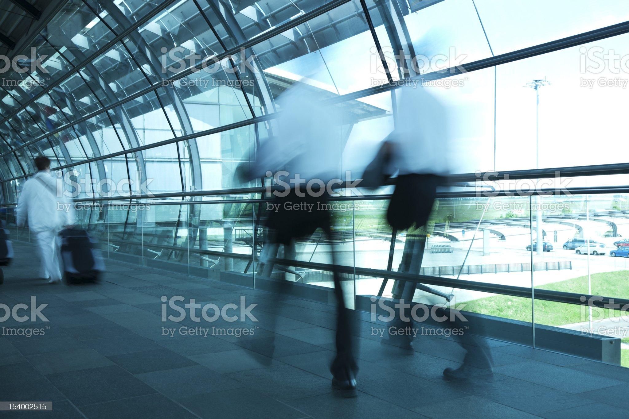 Two Businessmen Walking Through Airport Corridor, Blurred Motion royalty-free stock photo
