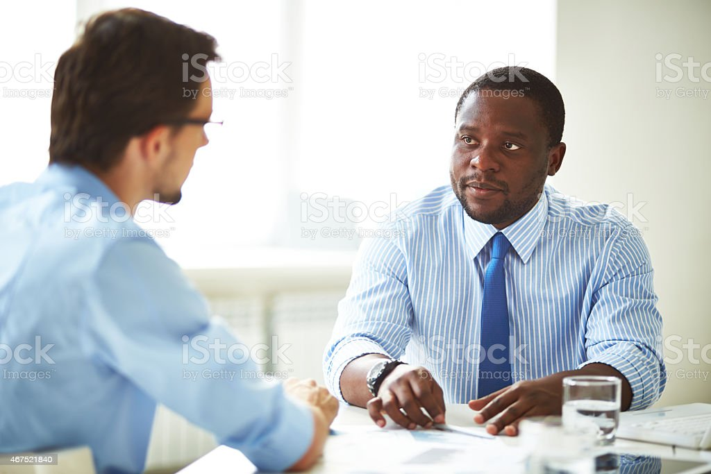 Two businessmen wearing blue shirts on job interview stock photo