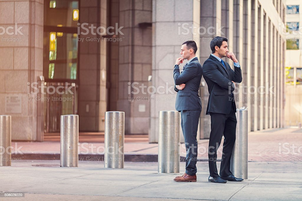 Two businessmen with conflicting ideas stock photo