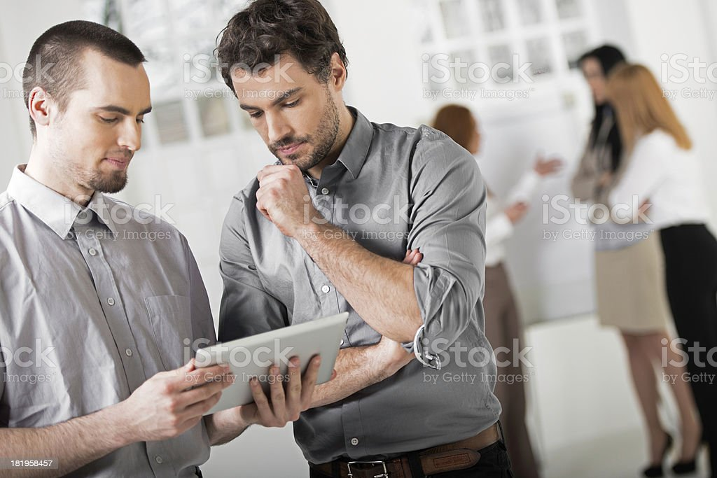 Two businessmen with digital tablet royalty-free stock photo