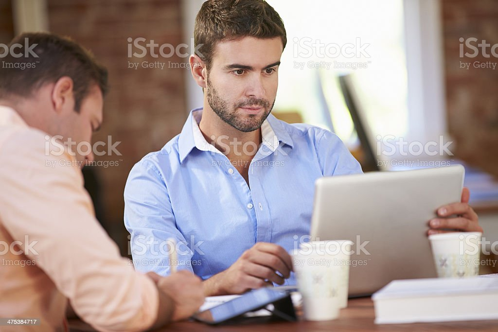 Two Businessmen Working At Desk Together royalty-free stock photo