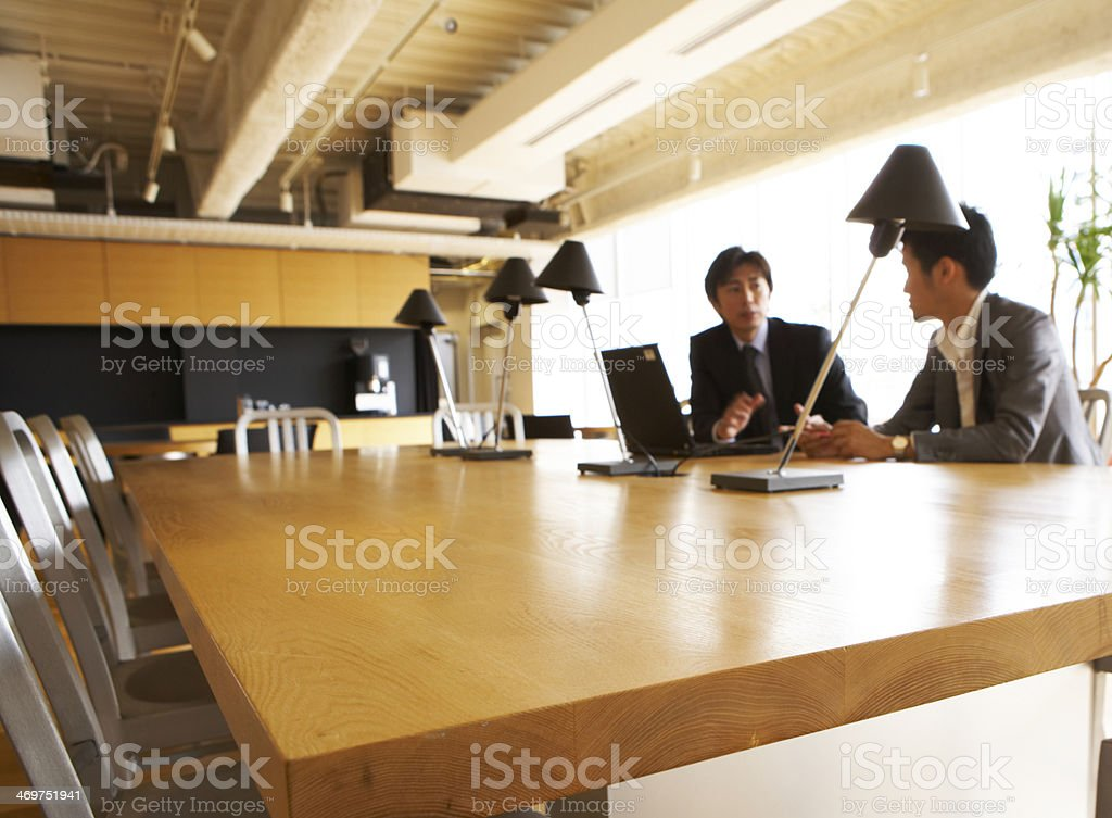 Two Businessmen Working in Conference Room stock photo