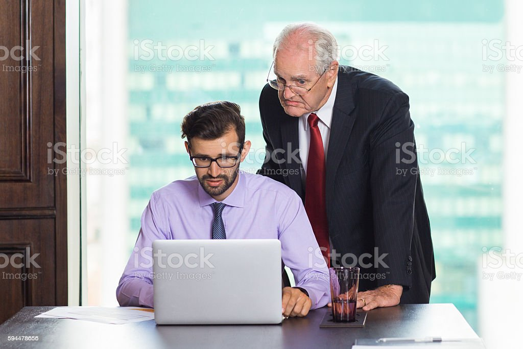 Two Businessmen Working on Laptop stock photo