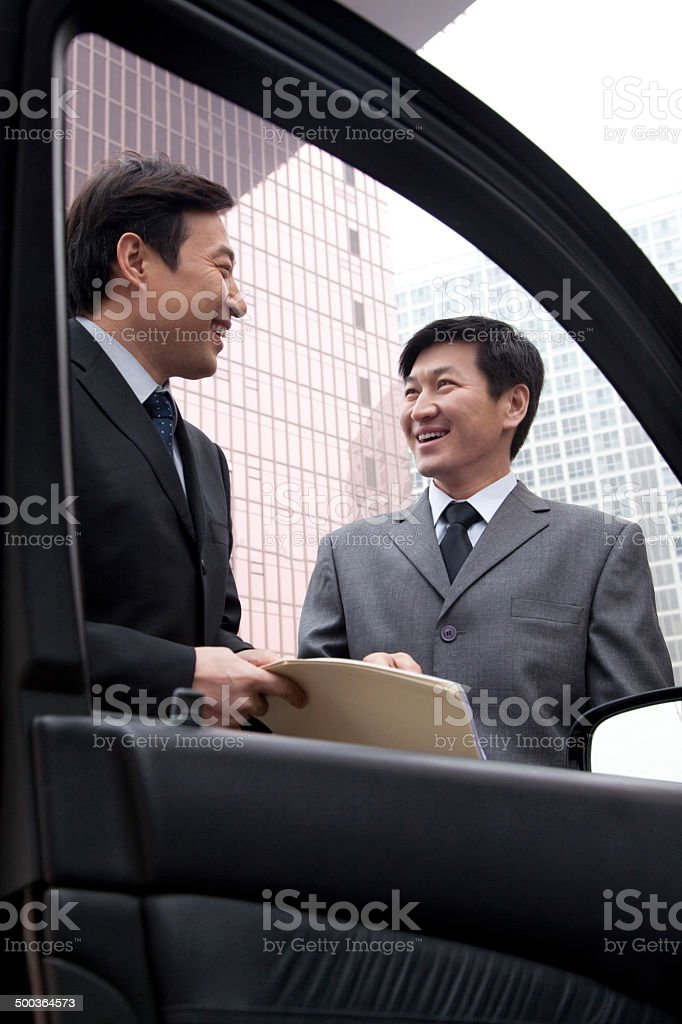 Two businessmen working outside royalty-free stock photo