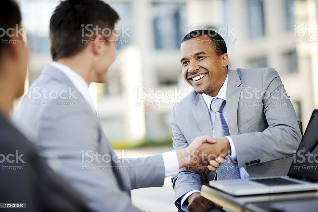 Two businesspartners making a business deal. stock photo