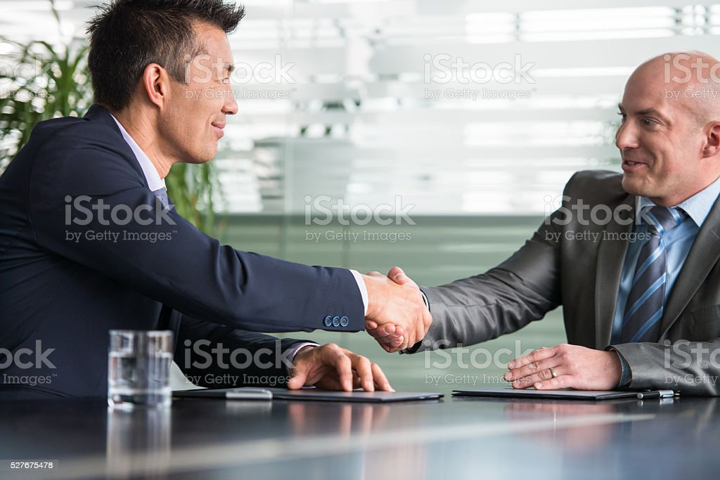 Two Businesspartners Making A Business Deal stock photo