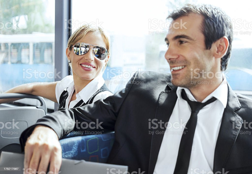 Two businesspeople commuting by bus. royalty-free stock photo