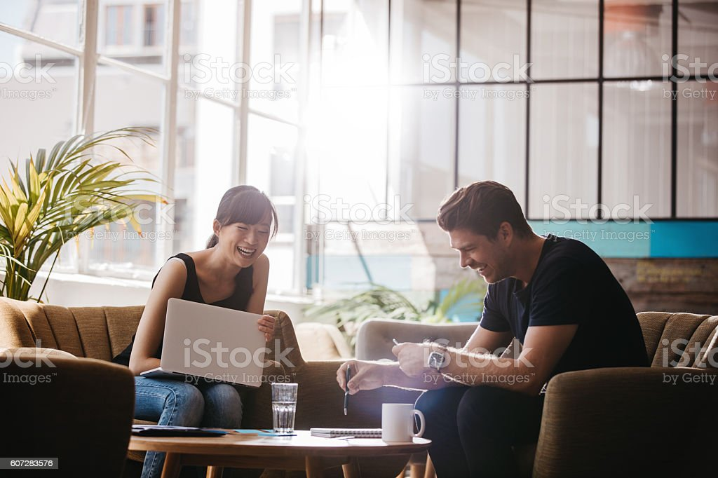 Two businesspeople having meeting in cafe stock photo