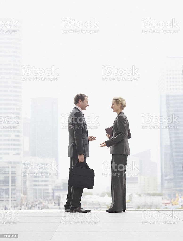 Two businesspeople outdoors at top of staircase royalty-free stock photo