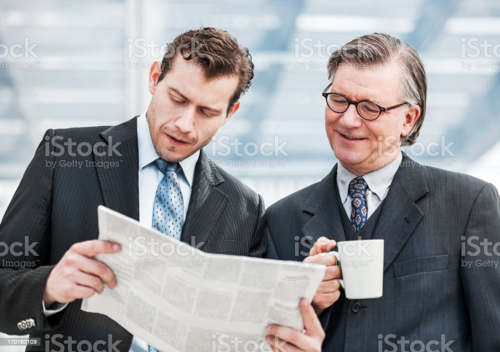 Two businesspeople reading the newspapers. royalty-free stock photo