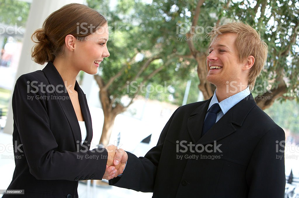 Two businesspeople shaking hands. stock photo