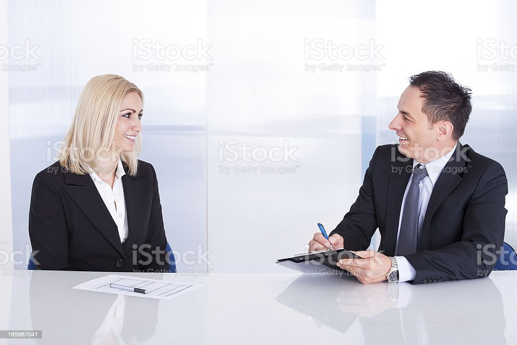 Two Businesspeople Talking With Each Other royalty-free stock photo