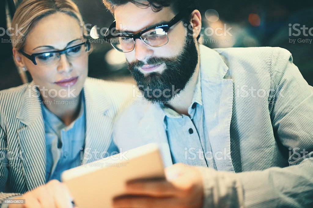 Two businesspeople using digital tablet. stock photo
