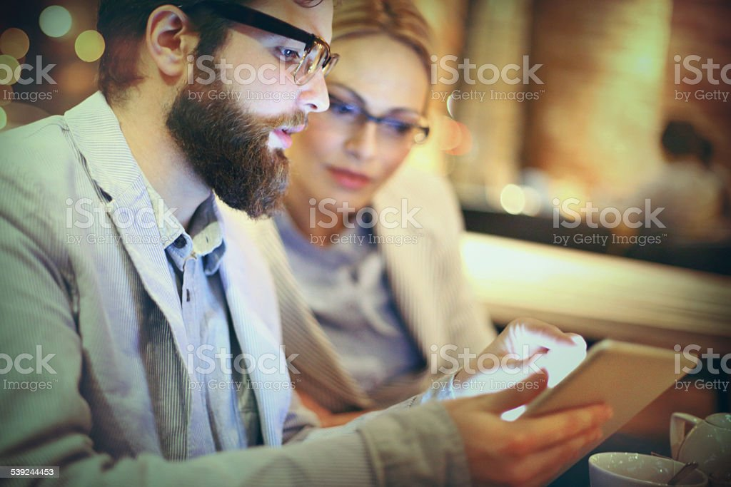 Two businesspeople using tablet. stock photo