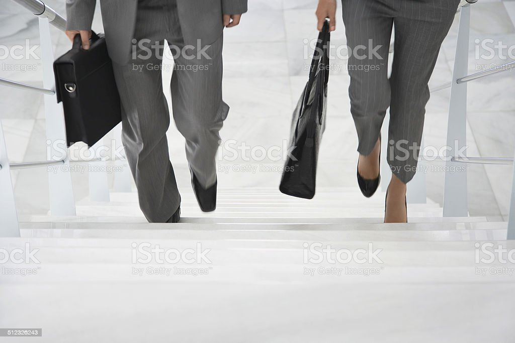 Two Businesspeople Walking Up Stairs stock photo