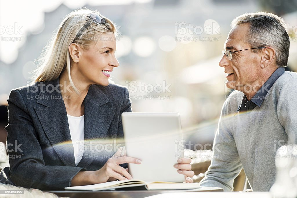 Two businesspeople working on a touchpad. royalty-free stock photo