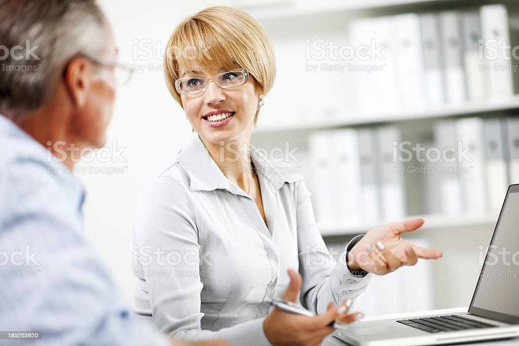 Two businesspeople working together on a computer. royalty-free stock photo