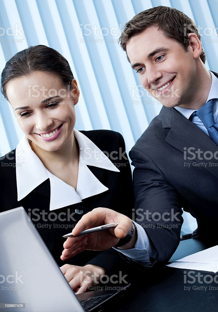 Two businesspeople working with laptop at office royalty-free stock photo