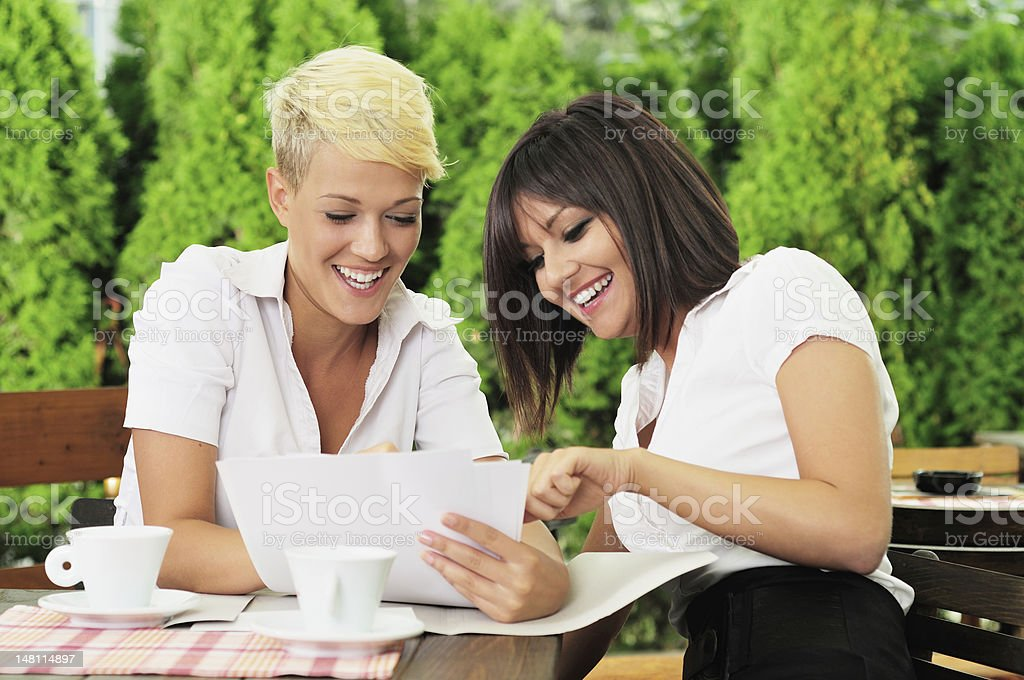 Two businesswoman reading documents royalty-free stock photo