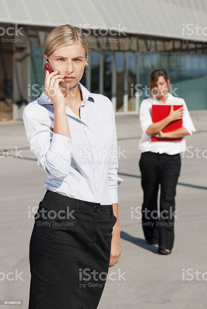 Two businesswoman working on the street stock photo
