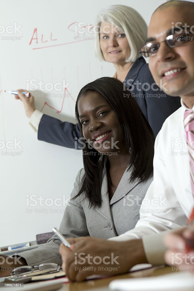 Two businesswomen and businessman at meeting stock photo