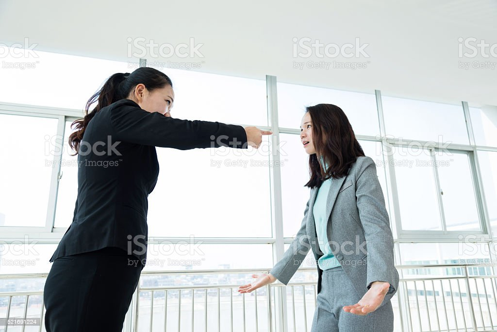 Two businesswomen arguing in office stock photo