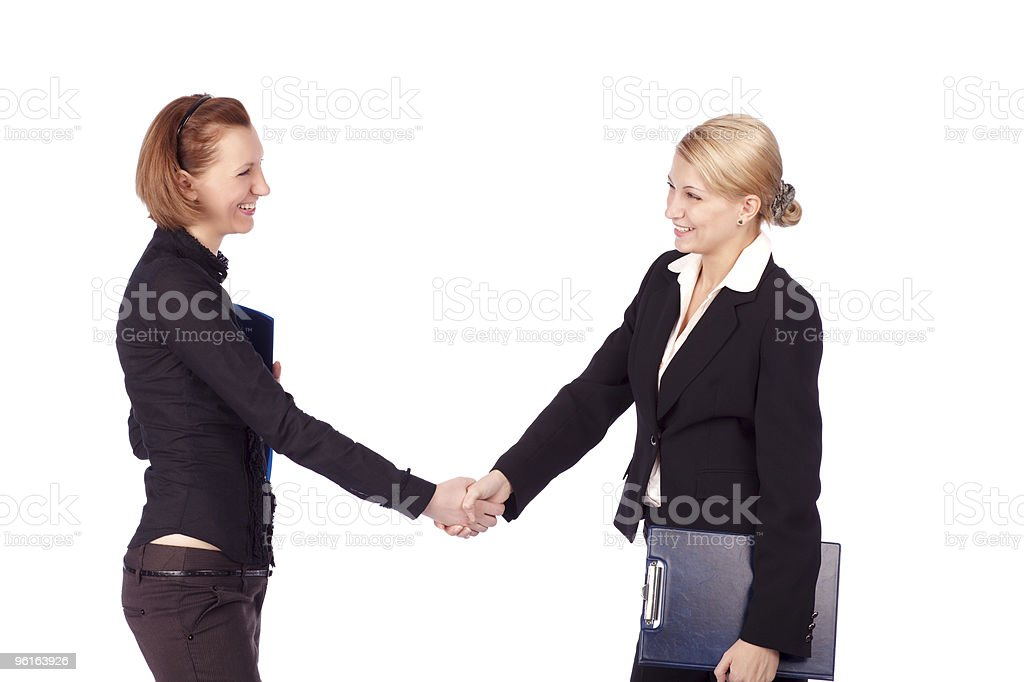 two businesswomen shaking hands royalty-free stock photo