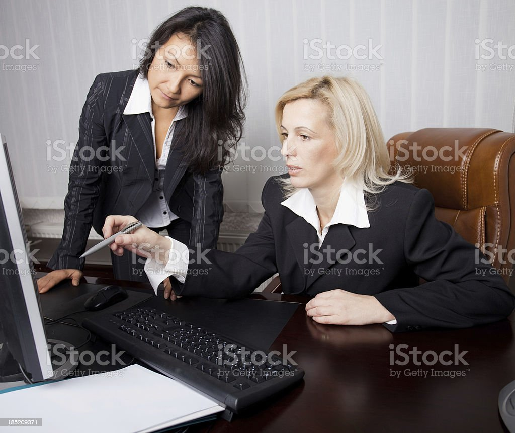 Two businesswomen working in the office. royalty-free stock photo