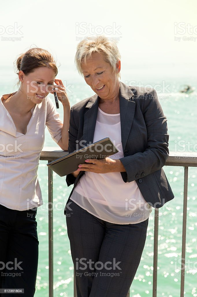 two businesswomen working outside the office stock photo