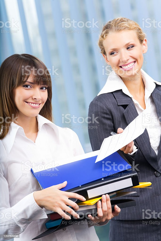 Two businesswomen working with documents at office royalty-free stock photo