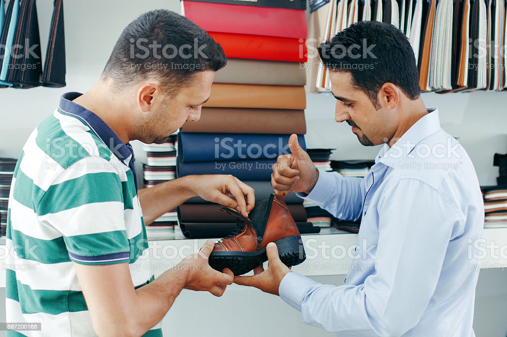 Two bussinesman discussing project design in office. stock photo