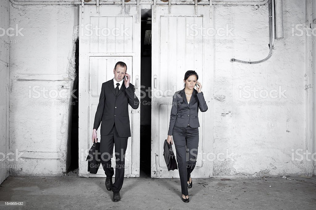 Two busy business people royalty-free stock photo