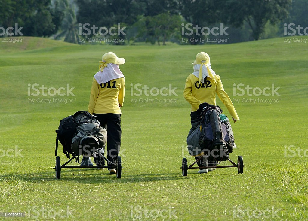Two caddies on a golf course stock photo