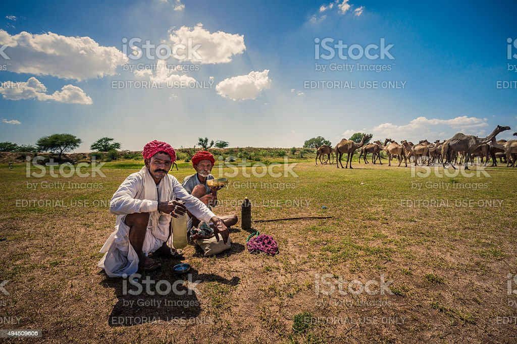 Two camel shepherds in the Thar desert Rajasthan India stock photo
